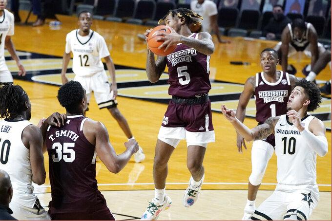 Mississippi State guard Deivon Smith (5) grabs a rebound in the first half of an NCAA college basketball game against Vanderbilt Saturday, Jan. 9, 2021, in Nashville, Tenn. (AP Photo/Mark Humphrey)