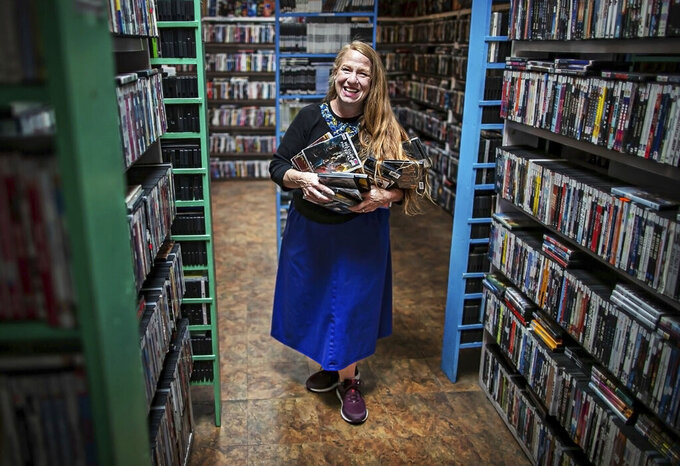 This undated image shows Lisa Harris, co-owner of Video Library in Santa Fe, New Mexico. The Video Library turned 40 this year and still does a brisk business in movie, TV show and foreign film rentals. (Jim Weber/Santa Fe New Mexican via AP)