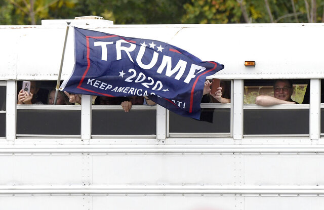Supporters of President Donald Trump arrive by bus for a Trump campaign rally at Harrisburg International Airport, Saturday, Sept. 26, 2020, in Middletown, Pa. (AP Photo/Steve Ruark)