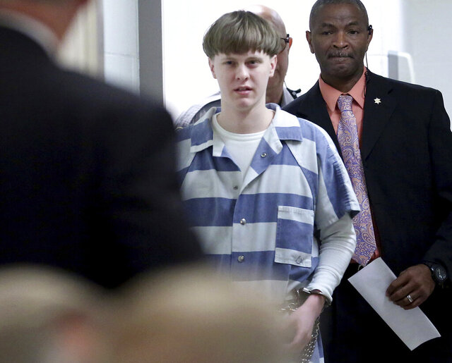 FILE - In this April 10, 2017, file photo, Dylann Roof enters the court room at the Charleston County Judicial Center to enter his guilty plea on murder charges in Charleston, S.C. White supremacist Roof on Tuesday, Jan. 28, 2020, appealed his federal convictions and death sentence in the 2015 massacre of nine black church members in South Carolina, arguing that he was mentally ill when he represented himself at his capital trial. (Grace Beahm/The Post And Courier via AP, Pool, File)