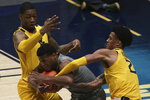 Baylor guard Jared Butler (12) is defended by West Virginia forwards Gabe Osabuohien (3) and Jalen Bridges (2) during the first half of an NCAA college basketball game Tuesday, March 2, 2021, in Morgantown, W.Va. (AP Photo/Kathleen Batten)