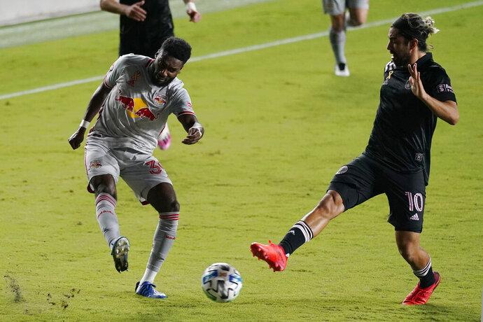New York Red Bulls defender Mandela Egbo, left, passes as Inter Miami midfielder Rodolfo Pizarro, right, defends during the second half of an MLS soccer match, Wednesday, Sept. 23, 2020, in Fort Lauderdale, Fla.  (AP Photo/Lynne Sladky)