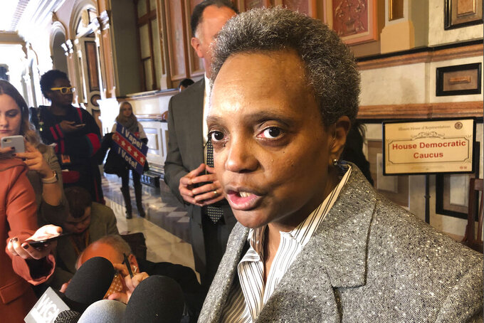 """FILE - In this Nov. 12, 2019, file photo, Chicago Mayor Lori Lightfoot talks to reporters after meeting with House Democrats at the state Capitol, in Springfield, Ill. Lightfoot announced Wednesday, May 19, 2021, that she will grant one-on-one interviews to mark the two-year anniversary of her inauguration solely to journalists of color, saying she has been struck by the """"overwhelming whiteness and maleness of Chicago media outlets.""""(AP Photo/John O'Connor, File)"""