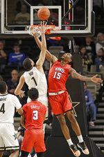 Vanderbilt forward Dylan Disu (1) shoots against SMU forward Isiaha Mike (15) during the first half of an NCAA college basketball game Saturday, Jan. 4, 2020, in Nashville, Tenn. (AP Photo/Mark Humphrey)