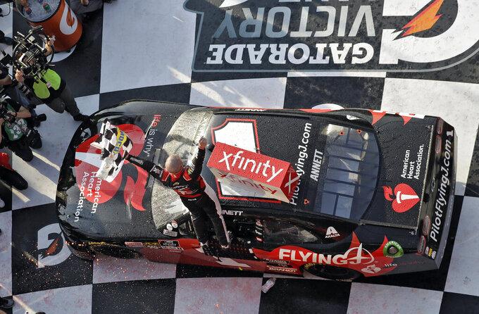 Michael Annett celebrates in Victory Lane after winning the NASCAR Xfinity auto race Saturday, Feb. 16, 2019, at Daytona International Speedway in Daytona Beach, Fla. (AP Photo/Chris O'Meara)