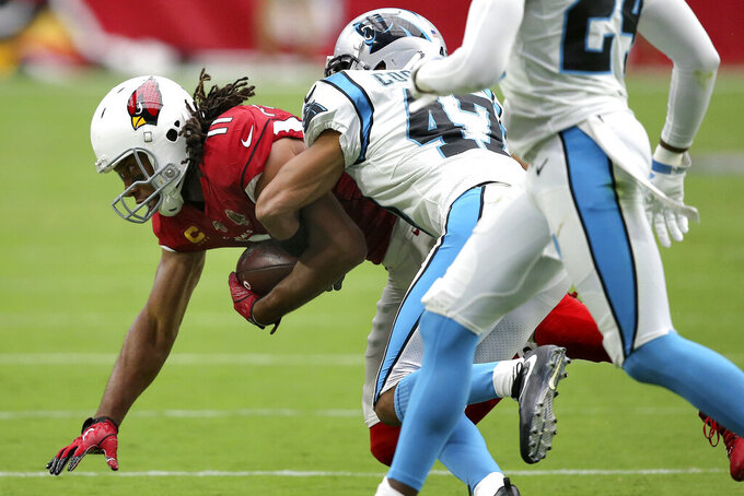 Arizona Cardinals wide receiver Larry Fitzgerald (11) is hit by Carolina Panthers defensive back Ross Cockrell during the first half of an NFL football game, Sunday, Sept. 22, 2019, in Glendale, Ariz. (AP Photo/Ross D. Franklin)