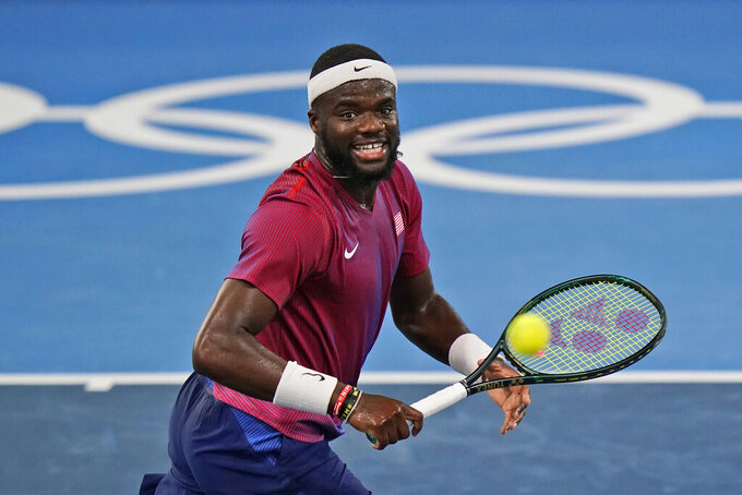 Frances Tiafoe, of the United States, plays Stefanos Tsitsipas, of Greece, during the second round of the tennis competition at the 2020 Summer Olympics, Tuesday, July 27, 2021, in Tokyo, Japan. (AP Photo/Seth Wenig)