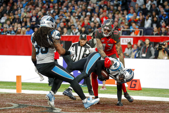 Carolina Panthers cornerback James Bradberry (24) intercepts a pass intended forTampa Bay Buccaneers wide receiver Mike Evans (13) in the end zone late in the fourth quarter of an NFL football game, Sunday, Oct. 13, 2019, at Tottenham Hotspur Stadium in London. The Panthers won 37-26. (AP Photo/Alastair Grant)