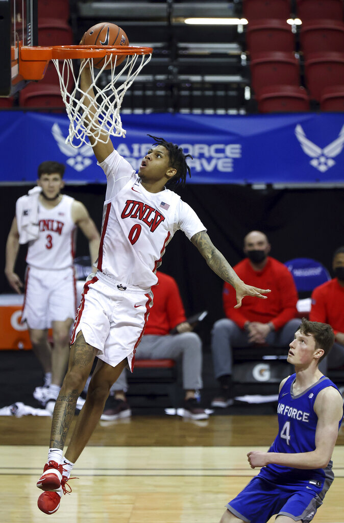 UNLV guard Donavan Yap (0) shoots in front of Air Force guard Carter Murphy (4) during the second half of an NCAA college basketball game in the first round of the Mountain West Conference men's tournament Wednesday, March 10, 2021, in Las Vegas. (AP Photo/Isaac Brekken)