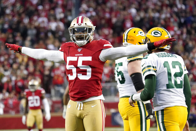 FILE - In this Sunday, Jan. 19, 2020 file photo, San Francisco 49ers defensive end Dee Ford (55) gestures next to Green Bay Packers quarterback Aaron Rodgers (12) during the first half of the NFL NFC Championship football game in Santa Clara, Calif. San Francisco edge rusher Dee Ford had an