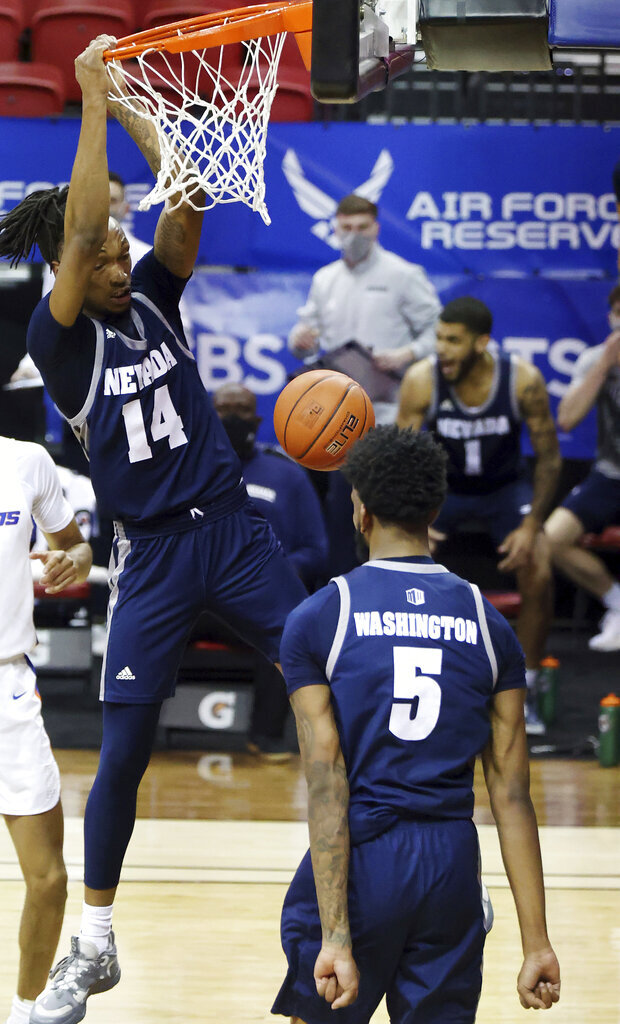 Nevada forward Tre Coleman (14) scores on an alley-oop from Warren Washington (5) during the second half of the team's NCAA college basketball game against Boise State in the quarterfinals of the Mountain West Conference men's tournament Thursday, March 11, 2021, in Las Vegas. (AP Photo/Isaac Brekken)
