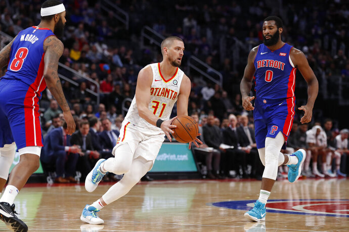 "FILE - In this Nov. 22, 2019, file photo, Atlanta Hawks forward Chandler Parsons (31) passes the ball during the second half of an NBA basketball game against the Detroit Pistons in Detroit. Parsons' attorneys say the Hawks forward suffered ""severe and permanent injuries"