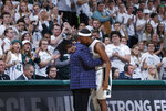 Michigan State's Cassius Winston and coach Tom Izzo embrace as Winston leaves the the team's NCAA college basketball game against Binghamton, Sunday, Nov. 10, 2019, in East Lansing, Mich. Michigan State won 100-47. (AP Photo/Al Goldis)