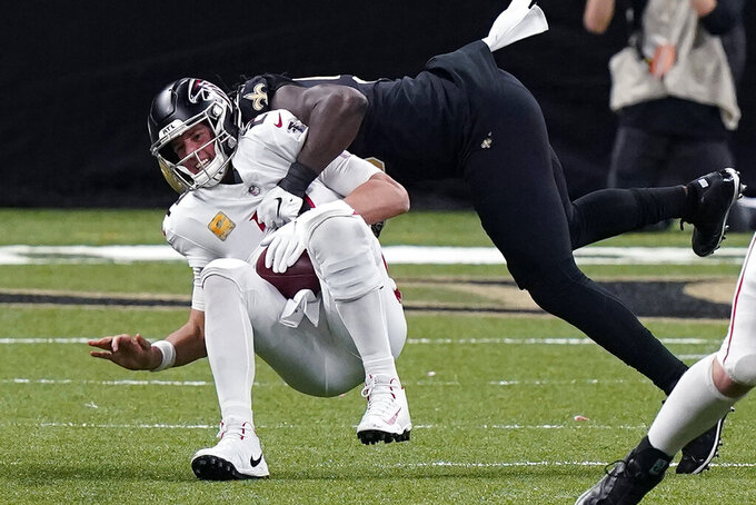 Atlanta Falcons quarterback Matt Ryan is sacked by New Orleans Saints outside linebacker Demario Davis in the second half of an NFL football game in New Orleans, Sunday, Nov. 22, 2020. (AP Photo/Butch Dill)