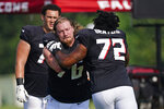 Atlanta Falcons offensive tackle Kaleb McGary (76) works against guard Willie Beavers (72) during an NFL training camp football practice Monday, Aug. 9, 2021, in Flowery Branch, Ga. (AP Photo/John Bazemore)