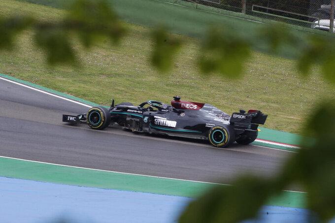 Mercedes driver Lewis Hamilton of Britain steers his car during the Emilia Romagna Formula One Grand Prix, at the Imola racetrack, Italy, Sunday, April 18, 2021. (AP Photo/Luca Bruno)