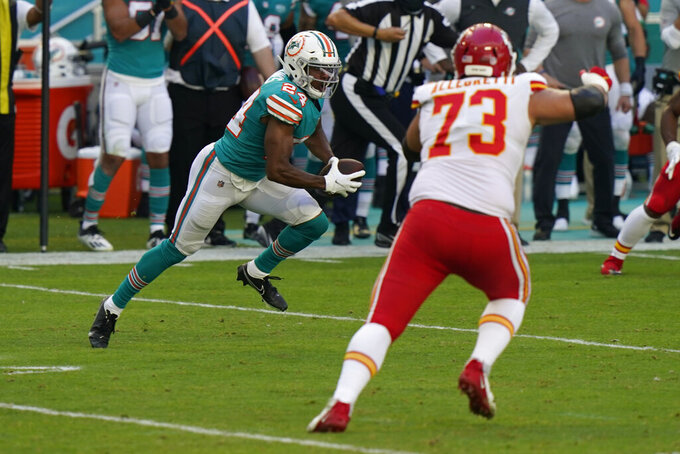 Miami Dolphins defensive end Emmanuel Ogbah (91) runs after intercepting a pass, during the first half of an NFL football game against the Kansas City Chiefs, Sunday, Dec. 13, 2020, in Miami Gardens, Fla. (AP Photo/Lynne Sladky)