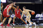 Washington guard Erik Stevenson drives past Utah guard Ian Martinez (2) during the second half of an NCAA college basketball game, Sunday, Jan. 24, 2021, in Seattle. Washington won 83-79. (AP Photo/Ted S. Warren)