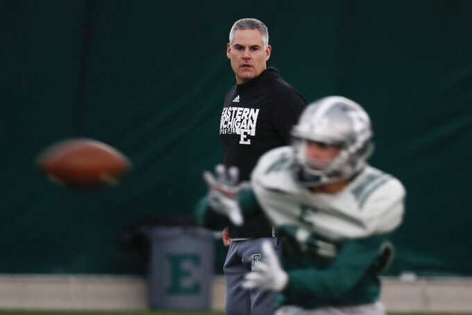 Eastern Michigan football coach Chris Creighton watches during practice in Ypsilanti, Mich., Monday, Dec. 10, 2018. The Eagles will face Georgia Southern in the Camellia Bowl on Saturday, earning a spot in NCAA football postseason play for the second time in three years and just the third time in school history. (AP Photo/Paul Sancya)