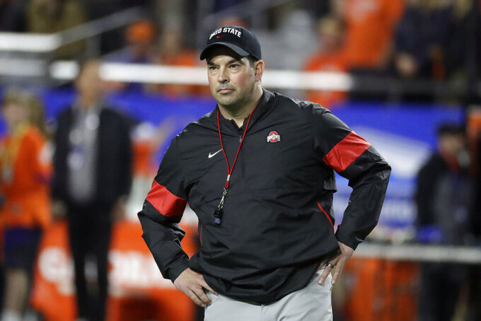 FILE - Ohio State head coach Ryan Day watches during the first half of the Fiesta Bowl NCAA college football game against Clemson in Glendale, Ariz., in this Saturday, Dec. 28, 2019, file photo. The National signing day period begins Wednesday, Feb. 3, 2021. (AP Photo/Rick Scuteri, File)