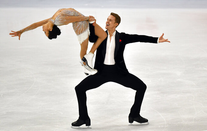 Madison Chock and Evan Bates of the USA perform during the Ice Dance - Rhythm Dance at the Figure Skating World Championships in Stockholm, Sweden, Friday, March 26, 2021. (AP Photo/Martin Meissner)