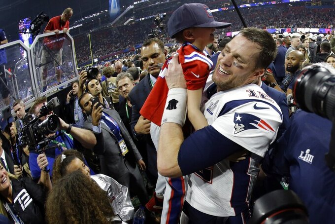 New England Patriots' Tom Brady lifts his son, Ben, after the NFL Super Bowl 53 football game against the Los Angeles Rams, Sunday, Feb. 3, 2019, in Atlanta. The Patriots won 13-3. (AP Photo/Mark Humphrey)