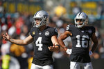 Oakland Raiders quarterback Derek Carr (4) reacts after a play as wide receiver Tyrell Williams (16) looks on during the second half of an NFL football game against the Kansas City Chiefs Sunday, Sept. 15, 2019, in Oakland, Calif. (AP Photo/D. Ross Cameron)