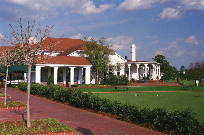 FILE - The clubhouse at Pinehurst Resort in Pinehurst, N.C., is shown April 3, 2002. The United States Golf Association announced Wednesday, Sept. 9, 2020, it will move its equipment testing center and other offices to North Carolina as part of a $36 million investment within the iconic golfing village of Pinehurst. (AP Photo/Randy Bergmann, File)