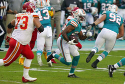Miami Dolphins cornerback Byron Jones (24) runs after intercepting a pass, during the first half of an NFL football game against the Kansas City Chiefs, Sunday, Dec. 13, 2020, in Miami Gardens, Fla. (AP Photo/Lynne Sladky)