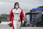 Simona De Silvestro, of Switzerland, walks through the garage area during testing at the Indianapolis Motor Speedway, Thursday, April 8, 2021, in Indianapolis. (AP Photo/Darron Cummings)