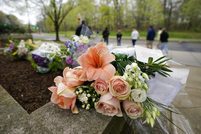 Flowers left by members of the public are seen outside the British Embassy in Washington, Friday, April 9, 2021. Buckingham Palace officials say Prince Philip, the husband of Queen Elizabeth II, has died. He was 99. Philip spent a month in hospital earlier this year before being released on March 16 to return to Windsor Castle. (AP Photo/Carolyn Kaster)