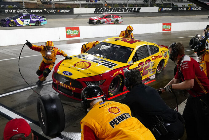 Joey Logano (22) makes a pit stop before rain halted the NASCAR Cup Series auto race at Martinsville Speedway in Martinsville, Va., Saturday, April 10, 2021. (AP Photo/Steve Helber)