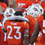 Virginia Tech's Keshawn King (23) is comforted by Jalen Holston (0) after a fumble during the first hal of an NCAA college football game against North Carolina on Friday, Sept. 3, 2021, in Blacksburg, Va. (Matt Gentry/The Roanoke Times via AP)