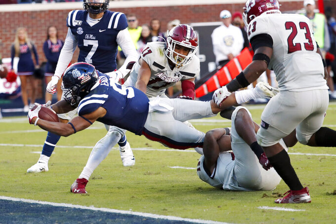 Mississippi running back Jerrion Ealy (9) dives into the end zone for 5-yard touchdown run past New Mexico State defensive back Jason Simmons Jr. (17) during the first half of an NCAA college football game in Oxford, Miss., Saturday, Nov. 9, 2019. (AP Photo/Rogelio V. Solis)