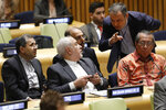 Iran's Foreign Minister Javad Zarif, second left, confers before his address to the High Level Political Forum on Sustainable Development, at United Nations headquarters, Wednesday, July 17, 2019. (AP Photo/Richard Drew)