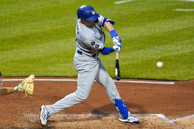 Los Angeles Dodgers' AJ Pollock hits an RBI double off Pittsburgh Pirates starting pitcher JT Brubaker during the fifth inning of a baseball game in Pittsburgh, Tuesday, June 8, 2021. (AP Photo/Gene J. Puskar)
