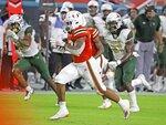 Miami running back Cam'Ron Harris (23) runs for a first-quarter touchdown against UAB during an NCAA college football game in Miami Gardens, Fla., Thursday, Sept. 10, 2020. (Al Diaz/Miami Herald via AP)