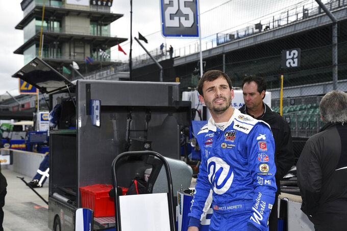 In a photo provided by IMS Photo, Jarrett Andretti waits before testing for the Freedom 100 Indy Lights auto race at Indianapolis Motor Speedway in Indianapolis on Monday, May 20, 2019. The 26-year-old Andretti is making his racing debut at the hallowed speedway on Friday, when the lower-tier Indy Lights series runs the Freedom 100 on Carb Day ahead of the Indianapolis 500. (Dana Garrett/IMS Photo via AP)
