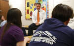 Jason Elmore, the prosecutor in Wexford County, Mich., listens to a student's question during a health class for high school freshmen in which he talked to them about consent for sexual activity in Cadillac, Mich., on Wednesday, April 17, 2019. Elmore has prosecuted a few students from the high school in the last year for criminal sexual conduct with teens victims younger than 16, the legal age of consent in Michigan. He said some of the victims were under the influence of alcohol or drugs. Elmore grew up in the town and attended this high school, though he said discussions like these were never part of his sex ed. He said social media has contributed to the problem, but he said more people are speaking up about sexual assault and abuse in the #MeToo era. (AP Photo/Martha Irvine)