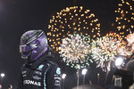 Mercedes driver Lewis Hamilton of Britain celebrates after winning the Bahrain Formula One Grand Prix at the Bahrain International Circuit in Sakhir, Bahrain, Sunday, March 28, 2021. (Lars Baron, Pool via AP)