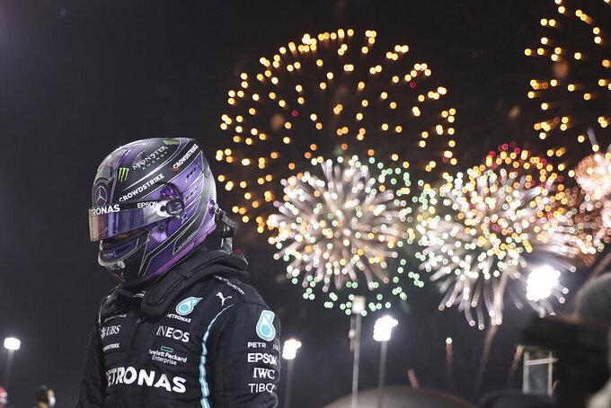 Mercedes driver Lewis Hamilton of Britain celebrates after winning the Bahrain Formula One Grand Prix at the Bahrain International Circuit in Sakhir, Bahrain, Sunday, March 28, 2021. (Lars Baron, Pool via AP)