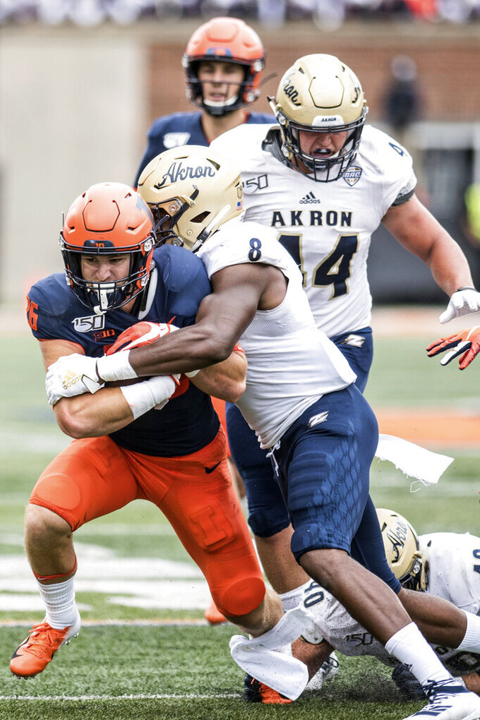 Illinois's Mike Epstein (26) runs the ball during the first half of an NCAA college football game against Akron, Saturday, Aug. 31, 2019, in Champaign, Ill. (AP Photo/Holly Hart)