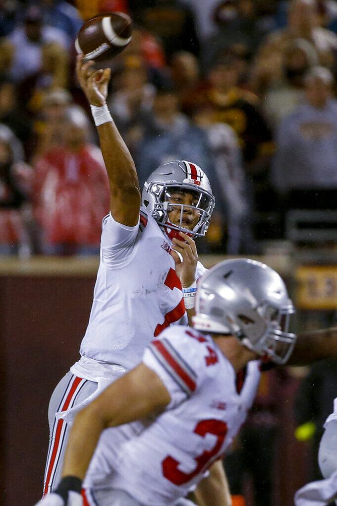 Ohio State quarterback C.J. Stroud (7) throws a touchdown pass against Minnesota during the third quarter of an NCAA college football game Thursday, Sept. 2, 2021, in Minneapolis. Ohio State won 45-31. (AP Photo/Bruce Kluckhohn)