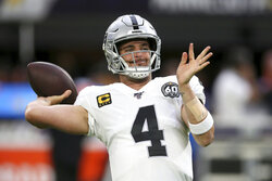 Oakland Raiders quarterback Derek Carr warms up before an NFL football game against the Minnesota Vikings, Sunday, Sept. 22, 2019, in Minneapolis. (AP Photo/Jim Mone)