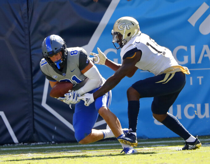 Duke tight end Davis Koppenhaver (81) makes a catch for a touchdown as Georgia Tech defensive back Christian Campbell (10) defends during the second half of the an NCAA college football game, Saturday, Oct. 13, 2018, in Atlanta. Duke won 28-14. (AP Photo/John Bazemore)