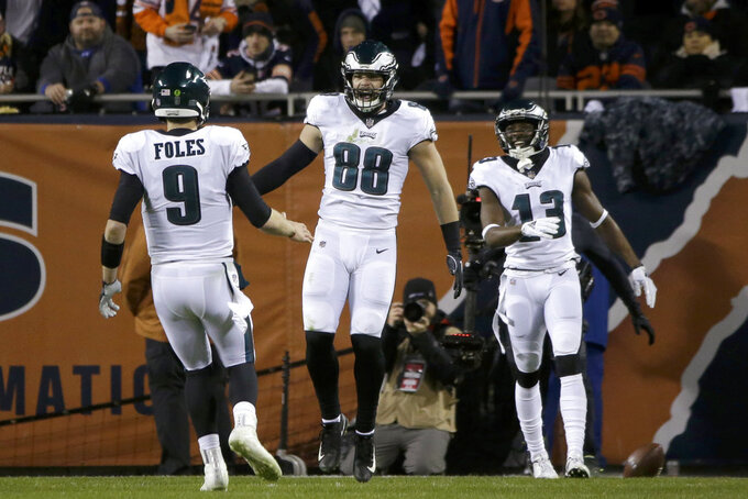 Philadelphia Eagles tight end Dallas Goedert (88) celebrates a touchdown with quarterback Nick Foles (9) during the second half of an NFL wild-card playoff football game against the Chicago Bears Sunday, Jan. 6, 2019, in Chicago. (AP Photo/David Banks)