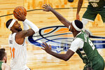 Orlando Magic guard Terrence Ross, left, takes a shot over Milwaukee Bucks center Bobby Portis (9) during the first half of an NBA basketball game, Monday, Jan. 11, 2021, in Orlando, Fla. (AP Photo/John Raoux)