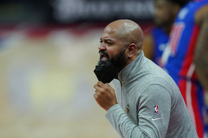 Cleveland Cavaliers head coach J.B. Bickerstaff directs from the sideline during the first half of an NBA basketball game against the Detroit Pistons, Monday, April 19, 2021, in Detroit. (AP Photo/Carlos Osorio)