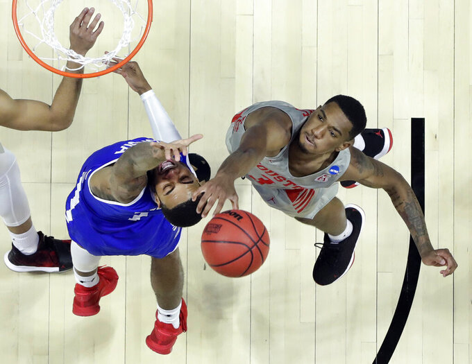 Houston's Armoni Brooks, right, knocks the ball away from Georgia State's Damon Wilson during the second half of a first round men's college basketball game in the NCAA Tournament Friday, March 22, 2019, in Tulsa, Okla. (AP Photo/Jeff Roberson)