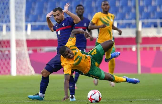 Teboho Mokoena of South Africa falls while battling for a ball with France's Teji Savanier during a men's soccer match at the 2020 Summer Olympics, Sunday, July 25, 2021, in Saitama, Japan. (AP Photo/Martin Mejia)